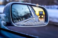 View in the side mirror of the car.  Stock Image