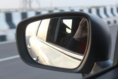 A view of side view mirror of car on a highway royalty free stock image