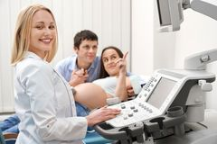 Qualified doctor in process of doing ultrasound diagnostic royalty free stock photos