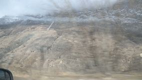 A view from the side window of the car in front of the seated passenger to the beautiful views of the Caucasus mountains. Sweeping past. Travel adventure video stock footage