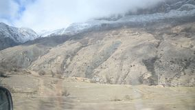 A view from the side window of the car in front of the seated passenger to the beautiful views of the Caucasus mountains. Sweeping past. Travel adventure video stock video footage