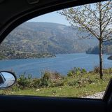 View through the side window of a rental car to a reservoir in the heart of Anatolia. Turkey Royalty Free Stock Photography