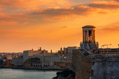 Siege Bell War Memorial and old fortress in Valletta, Malta royalty free stock image