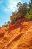 The view of sienna cliffs in outdoor park near from Roussillon Stock Images