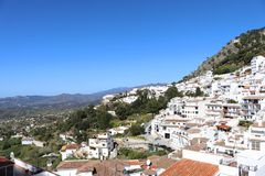 Mija Pueblo white village with Sierra de Mijas in the background. A view of the Sierra Mijas mountains from Mijas Pueblo white village in Spain royalty free stock image