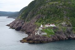 Fort Amherst lighthouse on the entrance of the St John`s harbour. View from Signal Hill towards the Fort Amherst lighthouse on the entrance of the St John`s stock photography