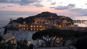 View of Silence Bay. Silence Bay at twilight from the top of the Vis a Vis hotel in Sestri Levante.This town is callen two seas city for its shape, in fact a stock image