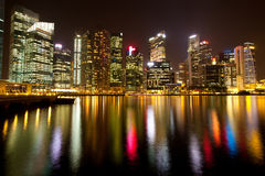 A view of Singapore in night with water reflection Stock Photos