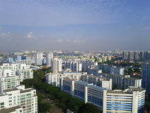 View of Singapore's flatted apartments. An unobstructed view from the roof of a tall building of the Clementi area of Singapore, showing the clear blue sky as Royalty Free Stock Photography
