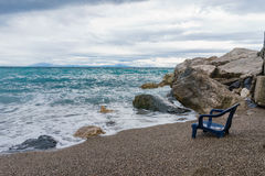 View of the sinking chair in front of the sea with soft gentle w Royalty Free Stock Photo