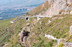 View of Sir Lowrys Pas. S in the Hottentots-Holland mountains near Somerset West, South Africa. The bridges over the old, unused roalroad is visible. Safety nets Royalty Free Stock Images