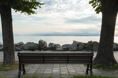 View of Sirmione, Lake garda from a bench in Desenzano, Italy. C Royalty Free Stock Images