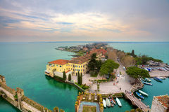 View on Sirmione and Lake Garda fro the castle. Aerial view from Scaglieri castle on Lake Garda and town of Sirmione in Italy Stock Photos
