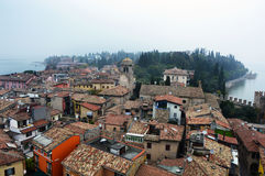 View of Sirmione town from the castle with fog Lake Garda in Italy Stock Image