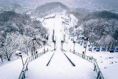 View from ski jump in Sapporo. Sapporo, Japan - March 11, 2015: Looking down the ski jump from the observation deck at Okurayama, home of the Winter Olympics in Stock Photography