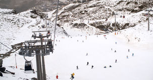 View from a ski lift of skiers below on run Royalty Free Stock Photo