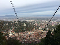 View from a ski lift towards mount tampa. In Brasov Romania Stock Photo