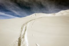 A view of a ski piste, ski mark and ski lift in the beautiful mountains of alps in st moritz switzerland in winter Royalty Free Stock Photo