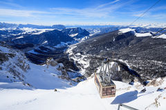 View of ski resort in Alps. Campitello di fassa, Italy -  January 31, 2015: There is a cable car on ski resort in Alps. You can see a beautiful view from the top Royalty Free Stock Photography