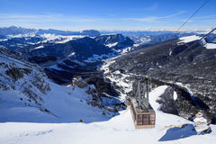 View of ski resort in Alps. Campitello di fassa, Italy -  January 31, 2015: There is a cable car on ski resort in Alps. You can see a beautiful view from the top Stock Photos