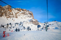 View of ski resort in Alps. Campitello di fassa, Italy -  January 31, 2015: There is a cable car on ski resort in Alps. You can see a beautiful view from the top Stock Photography