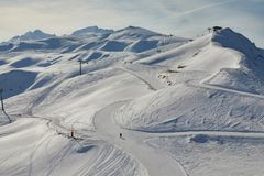 Skiing slopes, majestic Alpine landscape. View of the ski slopes of Les Sybelles Stock Photo