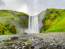 View of Skogafoss waterfalls in a cloudy day. In summer Iceland Royalty Free Stock Image