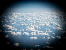 View of sky and clouds from airplane porthole royalty free stock images