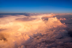 View of the sky and clouds from the airplane porthole Stock Image