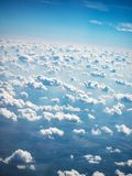 View of sky and clouds from airplane porthole stock photos