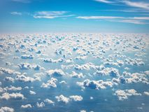 View of sky and clouds from airplane porthole stock photo