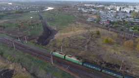 View from the sky on a freight train carrying coal, drone flying over the freight train stock video