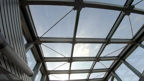 Glass roof in the subway. View of the sky through the glass roof of the subway stock video footage