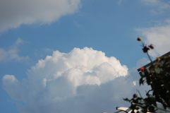 View of Large White Clouds in Blue sky from beneath royalty free stock photo