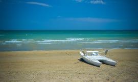 View of sky, sea, sand and catamaran, Pineto Stock Photo