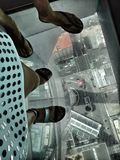 People are standing on a glass floor Sky Tower, Auckland Stock Image