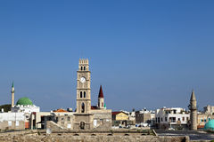 Old Acco Skyline. View at the skyline of the old town of Acco (Acre) in Israel. The famous Ottoman clock tower and Al-Jazzar mosque (with the green dome) can be Royalty Free Stock Images
