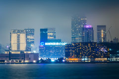 View of the skyline of Tsim Sha Tsui at night, seen from the Exp Stock Photos