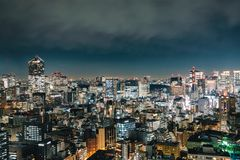View of skyscraper building with glowing light in metropolis cit. Y at night Stock Images