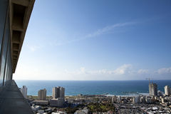 Skyscraper POV. A view from a skyscraper to the west showing part of the cityscape  and beach of Tel-Aviv, the largest metropolis in Israel Stock Photos
