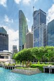 View of skyscrapers at downtown of Singapore. Scenic cityscape. Beautiful view of skyscrapers at downtown and azure water of Marina Bay in Singapore. Modern high royalty free stock photography