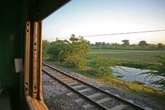 View from the sleeper car out to the burma countryside on the Yangon to Mandalay sleeper train. Early morning passing through rural Burma aboard the Yangon to Royalty Free Stock Photos