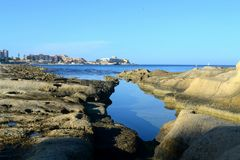 A view from Sliema shore in Malta. A view from Sliema rocky shore into St. Julian bay in Malta Island Stock Images