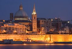 Valletta At Night, Malta. View from Sliema to Valletta with the St. Pauls Cathedral and the Charmelite Church, Malta Stock Photo