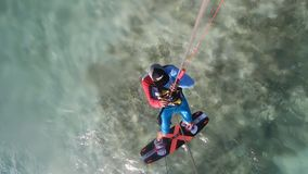 High speed gliding on water by a kite surfer out in the sea, action camera