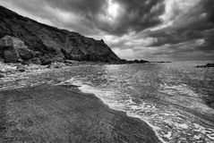 Looking out to sea from the slipway at Priest`s Cove, Cape Cornwall, as the storm clouds gather overhead. The view from the slipway at Priest`s Cove, towards stock image