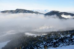 The view on slope and fog in Jasna Low Tatras royalty free stock photo