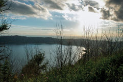 View of the slopes, forests and hills of Lake Albano in a cloudy sunset. stock photo