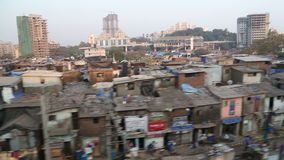 View on slum in Mumbai during a train ride. stock footage