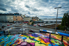 View of Slussen and graffiti on a building in, Södermalm, Stock Stock Photo